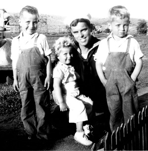 Jerry Don, Gwenda, and David with their Uncle Arden (Herb's brother) in 1944. Arden was killed in World War II.
