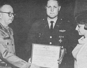 Captain Gerry A. Harr (center) receives the Distinguished Service Cross from Major General William W. Beverley, commanding general at Fort Lewis, Washington. At right is Gerry's wife, Pamela.