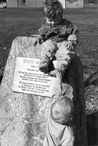 Two of Scott's three nephews play on the memorial rock placed at the starting line of the Paul Mariman Cross Country Course at Philomath High School.