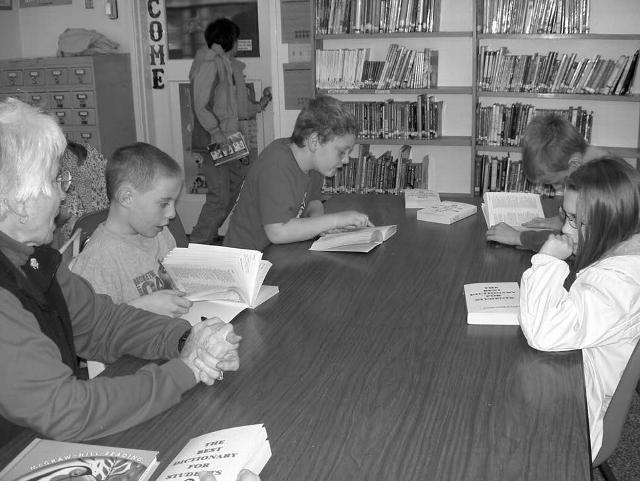 Children at Monroe Elementary School peruse the dictionaries made available through the efforts of the Philomath Rotary Club