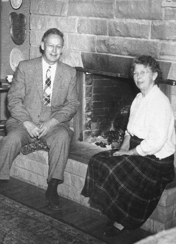 T.J. and Margaret Starker at their hearthside.