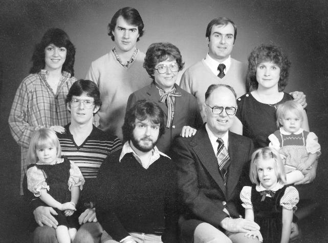 Marjorie is pictured at the center of her family, just as they were always at the center of her life. Pictured are David and Kevin (in back); Barbara, Marjorie, and Ann Campbell (middle); Dan and April Campbell, Rick, Chuck, Leslie, and Jessica (seated)